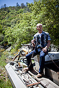 Gold miner James Butler sits on his mining dredge that has been banned for use on his mining claim on the Yuba River in the Sierra foothills near Smartsville, California, April 19, 2012..CREDIT: Max Whittaker/Prime for The Wall Street Journal.MINER