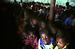 Children at an orphanage wait to eat at a feeding center in Huambo in the interior region of Angola.  Angola's brutal 26 year-civil has displaced around two million people - about a sixth of the population - and 200 die each day according to United Nations estimates.  .(Photo by Ami Vitale)