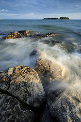 Waves crashing on the rocky shore near Cedarville, Michigan