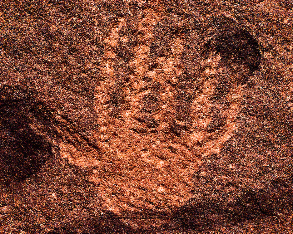 Incised style rock art representing a human hand. Hanakiyyah, Saudi Arabia