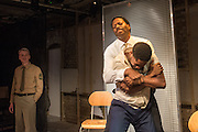 01/11/2012. London, UK. Arcola Studio 2, Dalston, presents: 'but i cd only whisper'.  The world premiere of a fierce and lyrical new work from Chicago. Directed by Nadia Latif and Written by Kristiana Colón. Picture shows Paul McEwan (uniform), Adetomiwa Edun & Cornell S John.