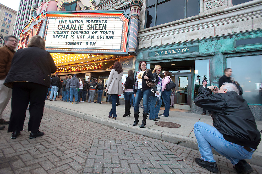Charlie Sheen fans pose for pictures in front of the Fox Theatre in Detroit, Michigan April 2, 2011 to see the first in Sheen's cross country tour of his show &quot;Violent Torpedo of Truth/Defeat is Not an Option&quot;.<br /> AFP/GEOFF ROBINS/STR