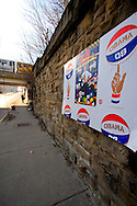 Posters celebrating Barack Obama's run for President line the streets on the south side of Chicago as a Red Line El train passes over 18th St.