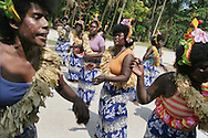 Island women practice their dancing and singing in preparation for an end of academic year school closing celebration, on Han Island, Carteret Atoll, Papua New Guinea, on Sunday, Dec. 10, 2006. Rising sea levels have eroded much of the coastlines of the low lying Carteret islands (situated 80km from Bougainville island, in the South Pacific), and waves have crashed over the islands flooding and destroying what little crop gardens the islanders have. Food is in short supply, banana and swamp taro crops are failing due to the salt contamination of the land, and the islanders live on a meagre one meal per day diet of fish and coconut. There is talk by the Autonomous Region of Bougainville government to relocate the Carteret Islanders to Bougainville island, but this plan is stalled due to a lack of finances, resources, land and coordination.