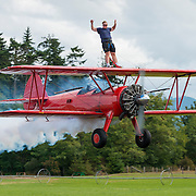 15 year old Weston Mason wing walks on a Stearman biplane, with his father Mike flying the plane. Mike and his wife Marilyn teach wing-walking to students from all over the world. http://www.westcoastspindoctors.com/wing_walking.html