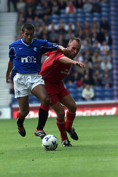 Giovanni van Bronckhorst and Moss during a Rangers v Dunfermline game in August 2000..