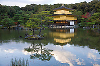 Kinkakuji, the Golden Pavilion, was built in 1393 as a retirement villa for Shogun Yoshimitsu Ashikaga.  He intended to cover the exterior with gold, but only managed to coat the the ceiling of the third floor with gold leaf before his death.  After his death, his son converted the building into a Zen temple of the Rinzai school named Rokuonji, in accordance with Ashikaga's wishes.