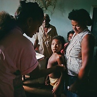 A Brazilian boy offers his arm for vaccination against Yellow Fever, a virus borne by mosquitos.