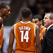 SHOT 2/26/11 4:45:49 PM - Texas head basketball coach Rick Barnes gives his team instructions during a timeout in their game against Colorado at the Coors Events Center in Boulder, Co. Colorado upset the fifth ranked Texas 91-89. (Photo by Marc Piscotty / © 2011)