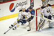 SHOT 2/25/17 8:33:35 PM - The Buffalo Sabres' Sam Reinhart #23 circles the net while being chased by the Colorado Avalanche's Matt Nieto #83 during their NHL regular season game at the Pepsi Center in Denver, Co. The Avalanche won the game 5-3. (Photo by Marc Piscotty / © 2017)