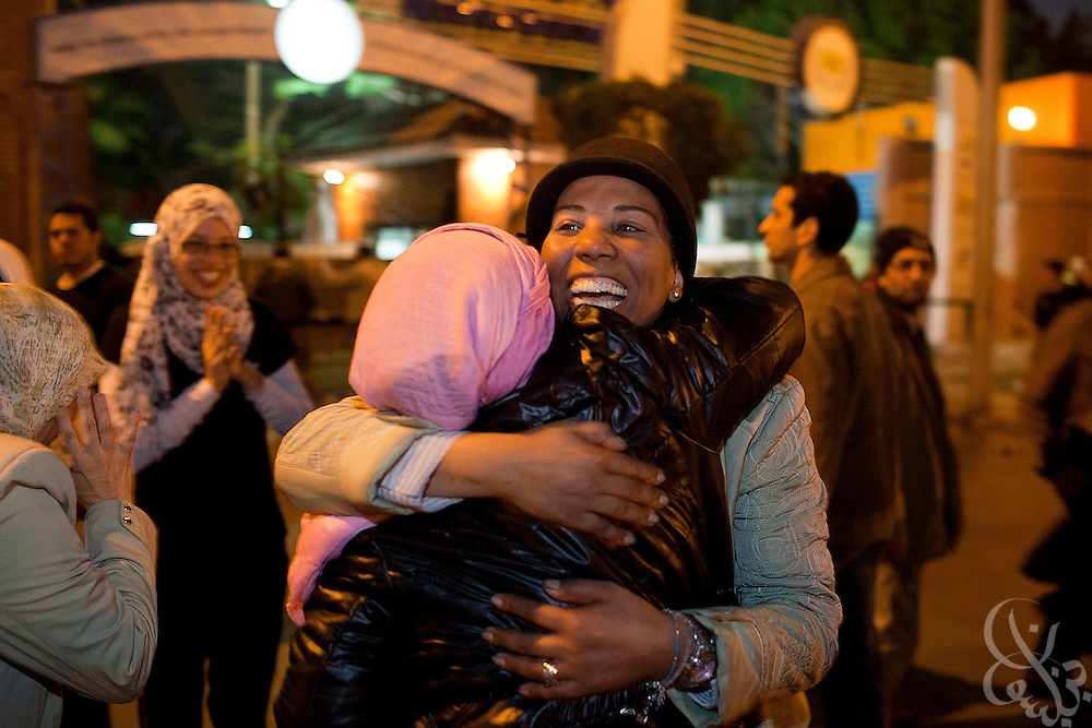 Egyptian women hug one another in the district of Heliopolis upon hearing the news that Egyptian President Hosni Mubarak had stepped down February 11, 2011 following momentous marches on the public buildings across Cairo, Egypt. (Photo by Scott Nelson)