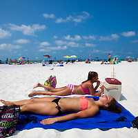 SARASOTA, FL -- June 14, 2011 -- Cassie Bonenfant, 18, foreground, and Hailey Mays, 18, who use SPF 30 on their faces and SPF 8 on their bodies, lay out on under the sun on vacation from Western New England College at Siesta Public Beach in Sarasota, Fla., on Tuesday, June 14, 2011.