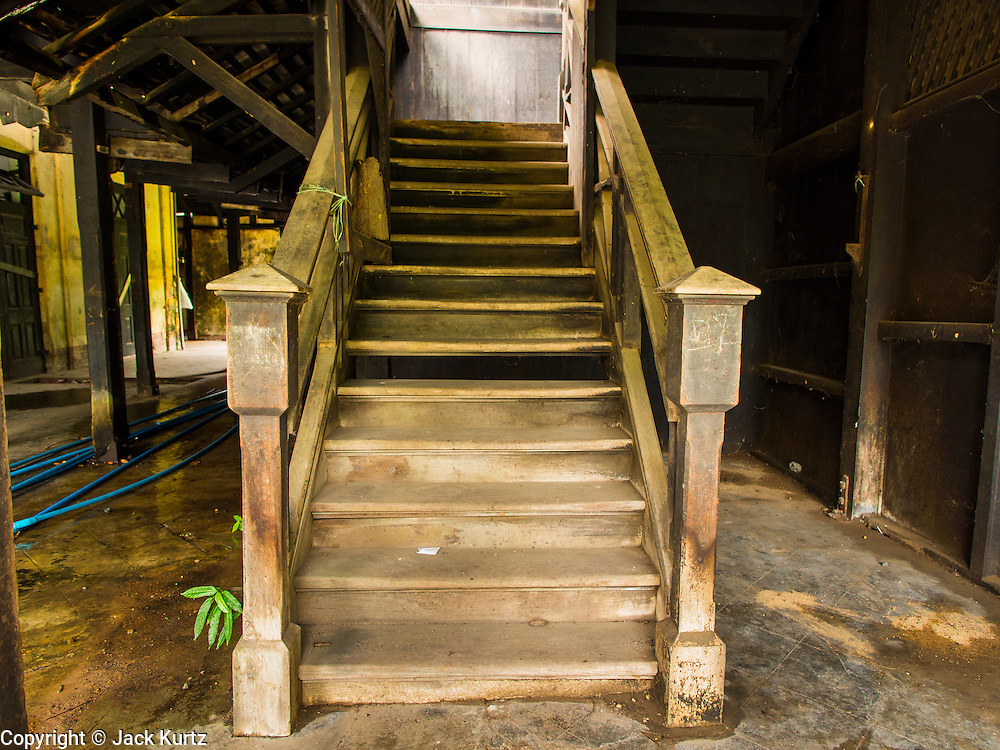07 JUNE 2014 - YANGON, MYANMAR: A wooden staircase at the Pegu Club. The Pegu Club in Yangon was the Officers' Club for the British Army when Myanmar was the British colony of Burma. The club, principally made of teak, is now abandoned and in decay. Squaters have moved into the parts of the complex still standing. Yangon has the highest concentration of colonial style buildings still standing in Asia. Efforts are being made to preserve the buildings but many are in poor condition and not salvageable.    PHOTO BY JACK KURTZ