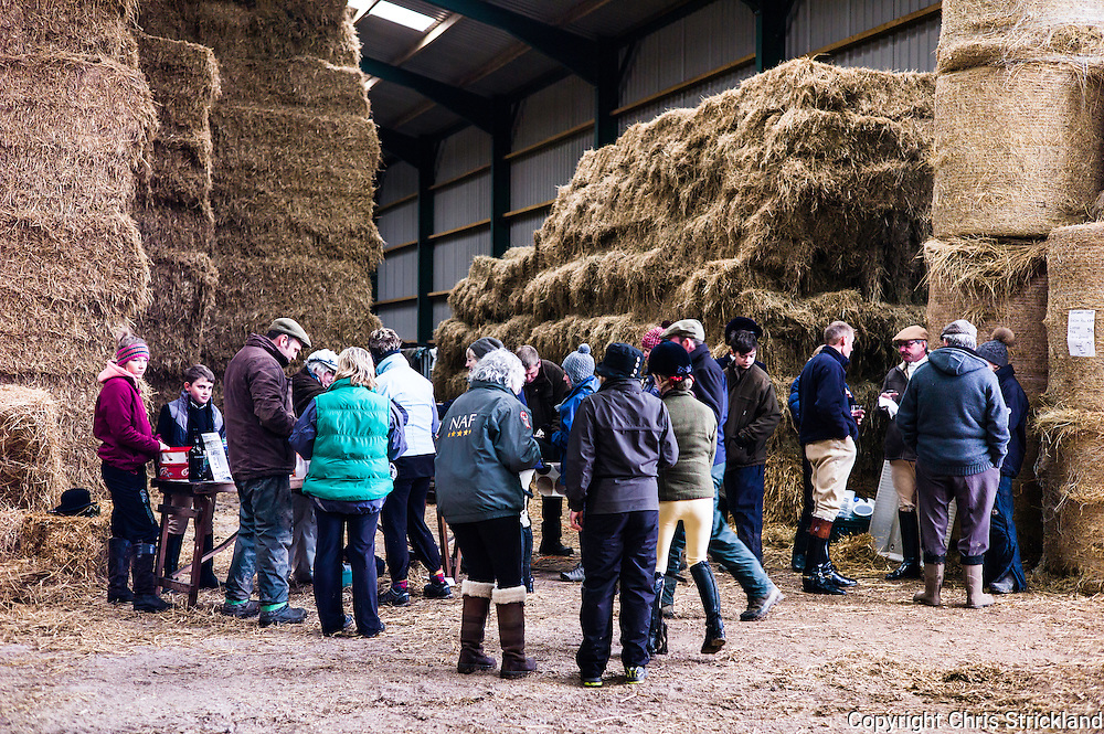Jedburgh, Scottish Borders, UK. 18th February 2016. The Jedforest Hunt hold a Bacon Roll meet in a farm building prior to hunting.