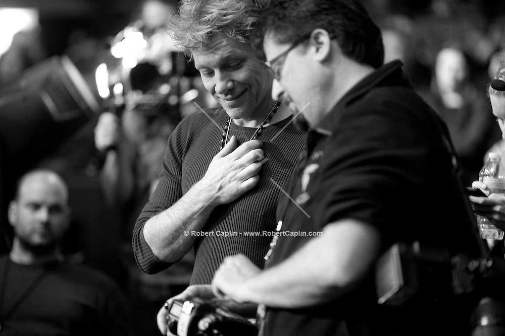 Jon bon Jovi and his photographer David Bergman photograph The Who at the 12-12-12 fundraising concert to aid the victims of Hurricane Sandy, will take place on December 12, 2012 at Madison Square Garden. The concert featured The Rolling Stones, Bon Jovi, Eric Clapton, Dave Grohl, Billy Joel, Alicia Keys, Chris Martin, Bruce Springsteen & the E Street Band, Eddie Vedder, Roger Waters, Kanye West, The Who, and Paul McCartney. All the proceeds went go to the Robin Hood Relief Fund. Robin Hood, the largest independent poverty fighting organization in the New York area, will insure that every cent raised will go to non-profit groups that are helping the tens of thousands.of people throughout the tri-state area who have been affected by Hurricane Sandy...Photo © Robert Caplin..