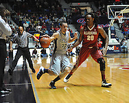 "Mississippi's Marshall Henderson (22) vs. Alabama guard Levi Randolph (20) at the C.M. ""Tad"" Smith Coliseum in Oxford, Miss. on Wednesday, February 26, 2014. (AP Photo/Oxford Eagle, Bruce Newman)"