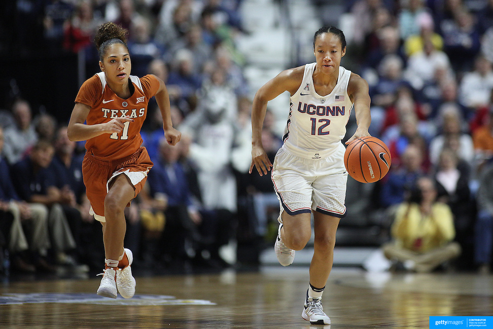 UNCASVILLE, CONNECTICUT- DECEMBER 4: Saniya Chong #12 of the Connecticut Huskies drives past Brooke McCarty #11 of the Texas Longhorns during the UConn Huskies Vs Texas Longhorns, NCAA Women's Basketball game in the Jimmy V Classic on December 4th, 2016 at the Mohegan Sun Arena, Uncasville, Connecticut. (Photo by Tim Clayton/Corbis via Getty Images)