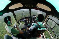 Anand Varma (left) and pilot Esteban Ramirez aboard a helicopter flying west of Yasuni National Park, Francisco de Orellana Province, Ecuador.