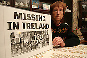 22/1/2007.JoJo Dollards sister Mary Phelan pictured at her home in Cuffesgrange County Kilkenny with a poster showing 48 missing people registered as missing on both side of the border in Ireland..Picture Dylan Vaughan.