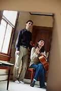 Benjamin Rous, the associate conductor for The Virginia Symphony Orchestra and his cellist fiancee Clara, in their Portsmouth, Virginia home on Wednesday, March 26, 2011.
