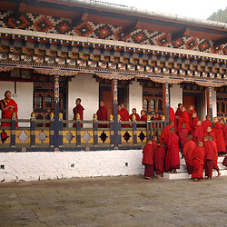 Monks practice a mask dance for the annual festival on November 7th, 2005 at the Old Dzong in Trashi Yengtse village in Eastern Bhutan October 15, 2005.l (Ami Vitale)