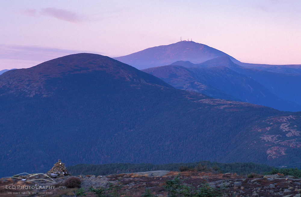 Mount Washington rises above the clouds and the Presidential Range in the White Mountain N.F.  From Mount Pierce.   Appalachian Trail. Dusk. Beans Grant, NH