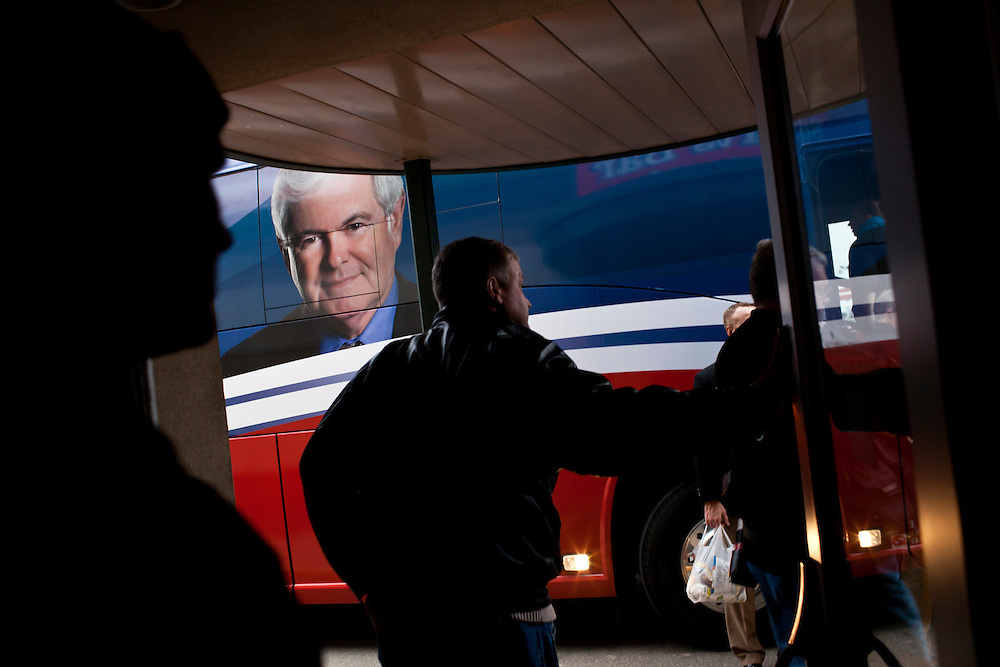 People leave after hearing Republican presidential candidate Newt Gingrich speak with voters at Junction Sports Bar & Grill on Sunday, January 1, 2012 in Marshalltown, IA.