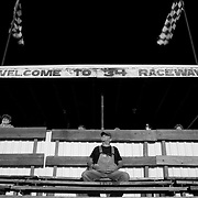 Scott Morgan/The Hawk Eye.Papy Brockway of Mediapolis sitting in the pit stands watching the feature races. Son John Brockway of Morning Sun is a driver...Saturday Aug. 12, 2006 at the 34 Raceway in Middletown, Iowa.