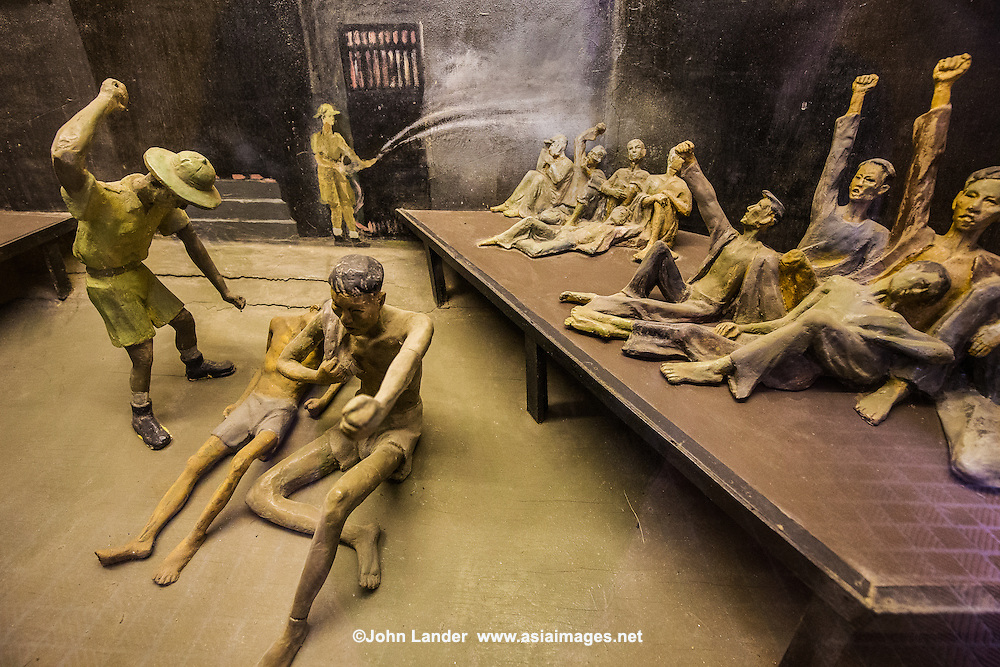 Diorama at Hoa Loa, Hanoi Hilton Prison - The original purpose of Hoa Loa Prison or the &quot;Hanoi Hilton&quot;<br /> was for the French colonial system detaining of Vietnamese criminals which usually meant anti-colonial activists seen as heroes by the Vietnamese&rsquo;.The prisoners themselves named it Hoa Lo meaning 'fiery furnace&rdquo;.   After the French left it was used to incarcerate a new line of inmates. During the American War, US forces pilots were detained in the during its period serving as a prisoner of war camp.  During the Vietnam War  the prison got a new nickname: the Hanoi Hilton.  Memoirs by former inmates speak of torture, murder and medical neglect.  The Vietnamese maintain that American prisoners were well treated.  Surviving the Hanoi Hilton boosted the career of US Republican Senator from Arizona John McCain.
