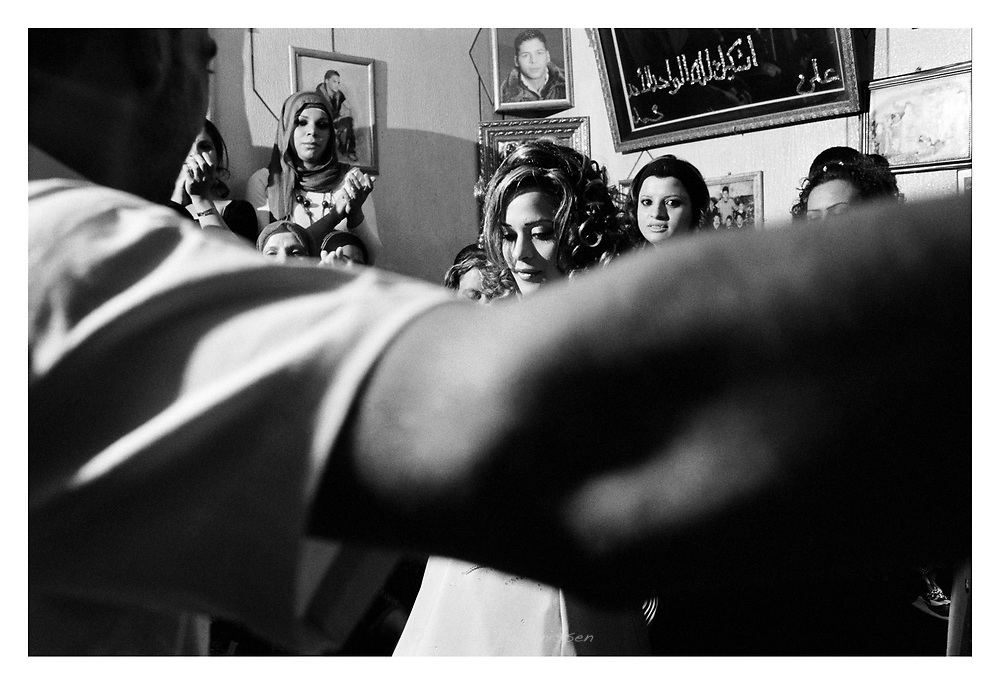 A young couple is dancing in front of the women of their families and village to celebrate their engagement and upcoming wedding. Aida refugee camp, Bethlehem, Palestine, 2007