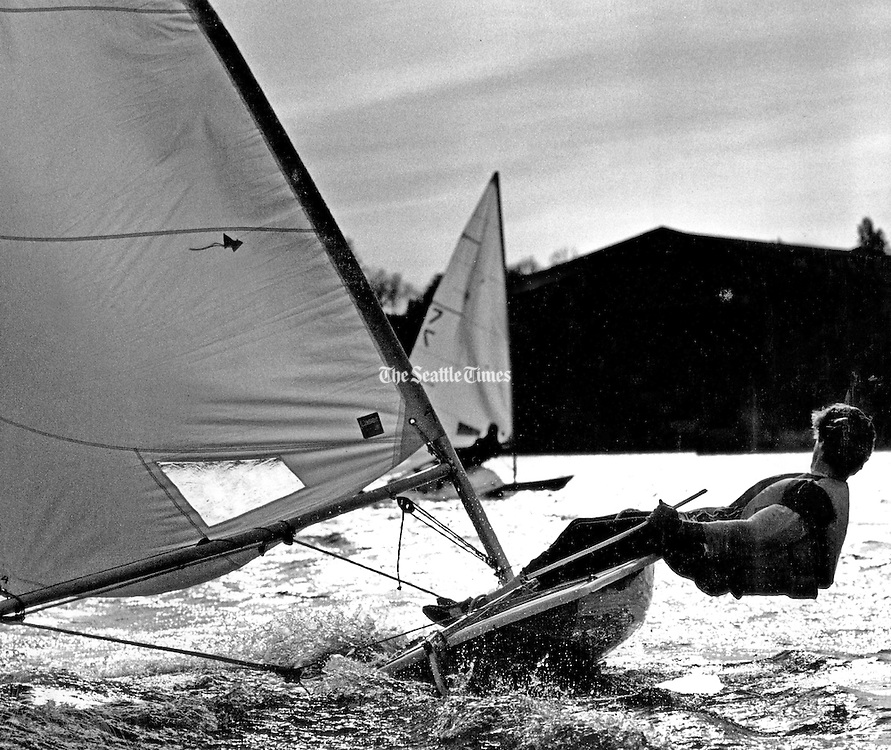 A Laser skipper hikes to starboard to keep his boat balanced during a race on Lake Washington. (Joe Scaylea / The Seattle Times, 1981)