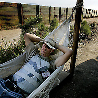 California Minuteman volunteer Britt Craig rests in his hammock before going on patrol along the U.S./Mexico Border in Campo, Calif. The controversial border-watch group has been staked out along parts of the California Border since July 16th in an attempt to stem the flow of illegal immigration and possible terrorist suspects trying to get into the United States.