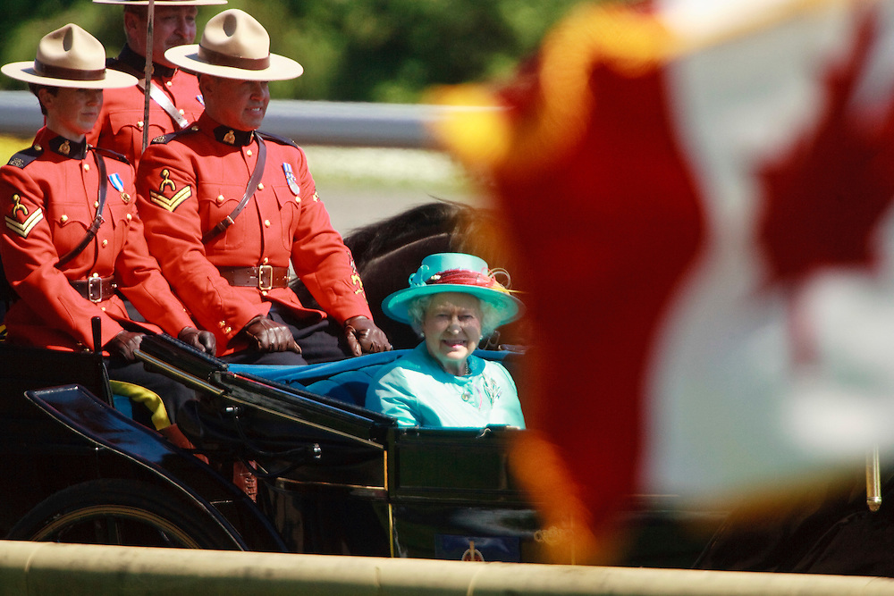 Queen Elizabeth II arrives at Woodbine racetrack in Toronto, Canada,  for the 151st running of the Queen's Plate, July 4, 2010. <br /> AFP/GEOFF ROBINS/STR