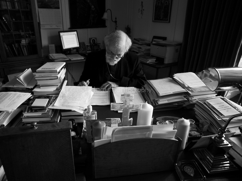 The Archbishop of Canterbury, Rowan Williams in his study at Lambeth Palace, London..OLYMPUS DIGITAL CAMERA