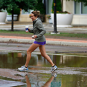 BOULDER, CO - SEPTEMBER 13: A pedestrian makes her way across leftover flood waters on Canyon Boulevard in Boulder, Colorado as heavy rains for the better part of week fueled widespread flooding in numerous Colorado towns on September 13, 2013. (Photo by Marc Piscotty/ © 2013)