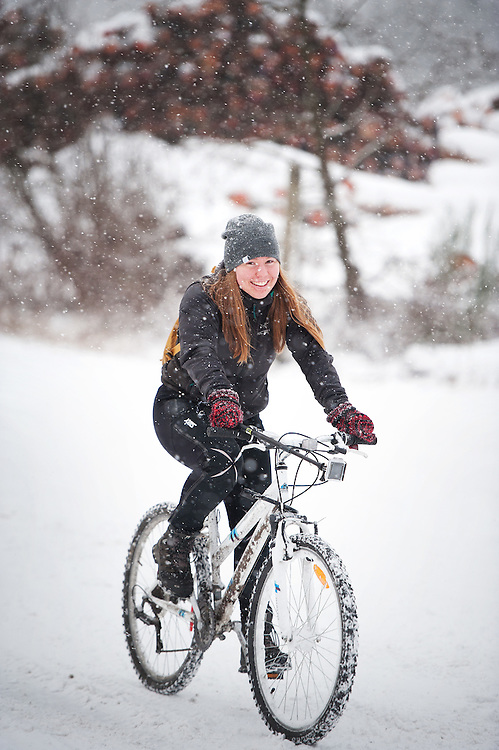 Norwegian exchange student Sunniva Soerheim rides her bike through the snow near Newport Beach during a snowstorm.