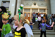 Costumed Chapman Elementary School K through Second graders leave the school after a fine performance of Bugz before family and friends. (LtoR) Majida Kalali-Aljarwan and her son Mohammad Al-Sarrar and Clara Edmonds were happy participants.