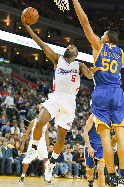 October 29, 2010; Oakland, CA, USA;  Los Angeles Clippers point guard Baron Davis (5) shoots past Golden State Warriors center Dan Gadzuric (50) during the second quarter at Oracle Arena.