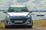 Blue Mazda 5 car in Poland on Hel pennisula on Baltic sea photo Piotr Gesicki