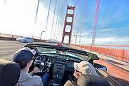 Couple in convertible on Golden GateBbridge,San Francisco, USA<br /> Model release 0330,0009