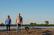 Kevin and Karen Boehler, dog Zac, evening walk on their farm, Yellowstone River, east of Fairview Montana, near its confluence with the Missouri River