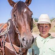 Colby McDonald and his bay mare horse at Warren Ranch at Katy Prairie Conservancy; Katy; Texas