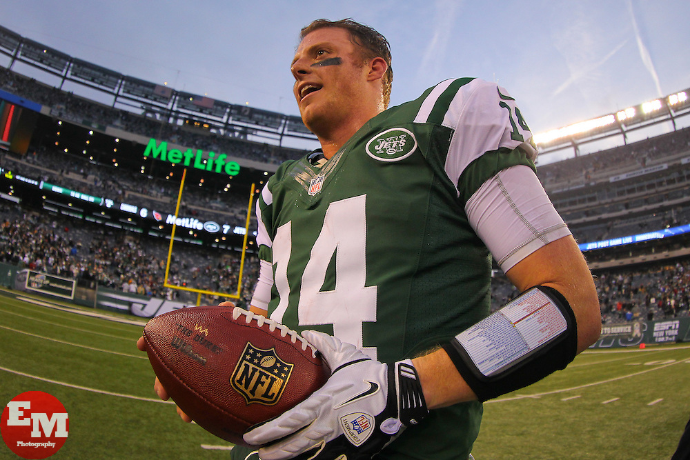 Dec 2, 2012; East Rutherford, NJ, USA; New York Jets quarterback Greg McElroy (14) celebrates the New York Jets 7-6 win over the Arizona Cardinals at MetLIfe Stadium.