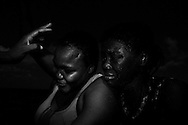 Italy, Southern Mediterranean sea: African migrants react on the boat with whom MSF staff rescued them from the rubber boat with which they left Libya on August 29, 2015. Alessio Romenzi
