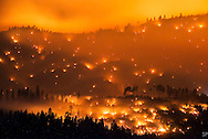 The El Portal Fire burns on a hillside in the Stanislaus National Forest and Yosemite National Park on Sunday evening July 27, 2014. The community of El Portal was under a mandatory evacuation. By Tuesday the blaze had burned nearly 3,000 acres. The El Portal Fire was the third significant blaze to occur in the park within the past few months. <br /> <br /> Long exposure image.