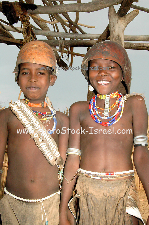 Africa, Ethiopia, Omo valley, Young boy (right) and girl (left) of the Arbore tribe calebasse helmet  girl can be distinguished by the seashell necklace