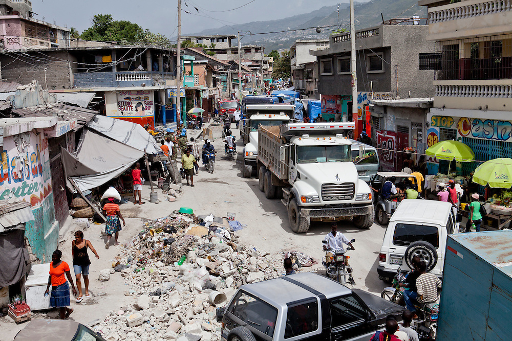 PORT-AU-PRINCE, HAITI - JULY 12: Dump trucks crowd the streets in the Bel-Air neighborhood on July 12, 2010 in Port-au-Prince, Haiti. Six months after an earthquake killed an estimated 230,000 people, many Haitians are struggling to rebuild their lives. (Photo by Brendan Hoffman/Getty Images) *** Local Caption ***