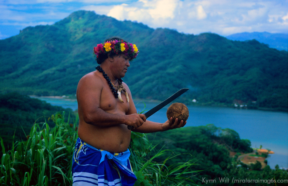 Oceania, South Pacific, French Polynesia, Tahiti, Taha'a. Tahitian demonstration of cutting coconut on island of Taha'a.