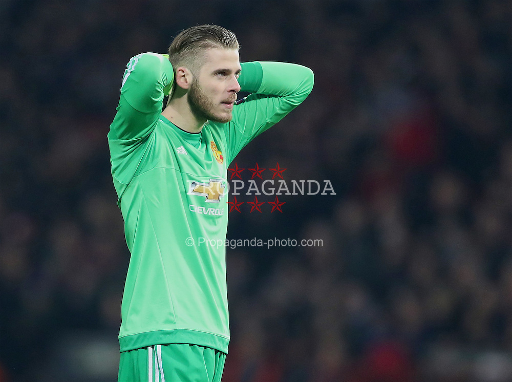MANCHESTER, ENGLAND - Wednesday, March 16, 2016: Manchester United's goalkeeper David de Gea looks dejected during the UEFA Europa League Round of 16 2nd Leg match against Liverpool at Old Trafford. (Pic by David Rawcliffe/Propaganda)