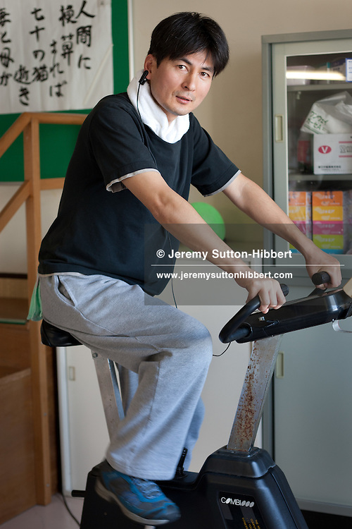 Hiromaru Sasazaki, survivor of the March 11th 2011 tsunami, undergoes rehabilitation for his injured knee, at hospital in Morioka city, Iwate prefecture, Japan, on Thursday 26th January 2012.